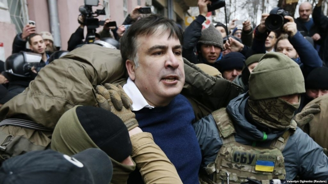 Georgia's ex-President Saakashvili threatens to jump off roof in Kiev